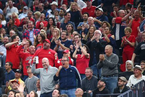 Arizona Wildcats fans react as their team plays the USC Trojans during the Pac-12 tournament ch ...