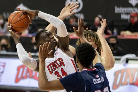 UNLV Rebels forward Cheikh Mbacke Diong (34) shoots over Fresno State Bulldogs forward Leo Coli ...