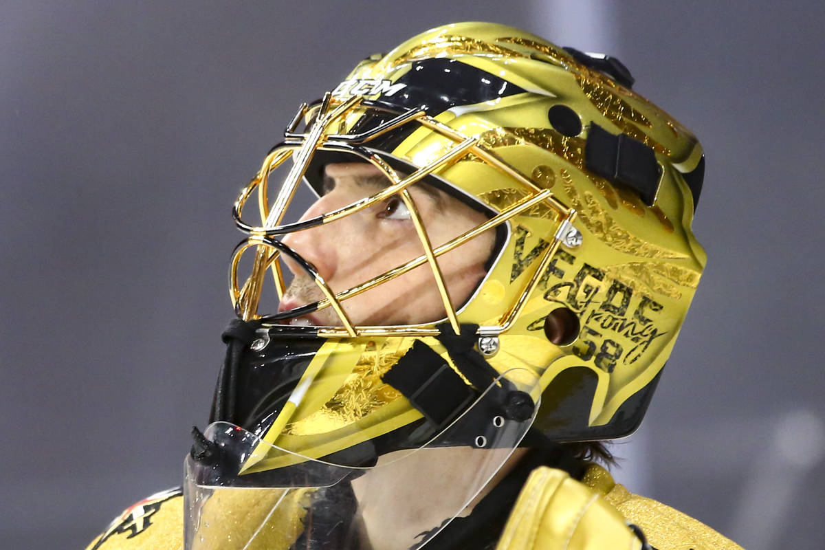 Golden Knights goaltender Marc-Andre Fleury looks on during an NHL hockey game at T-Mobile Aren ...