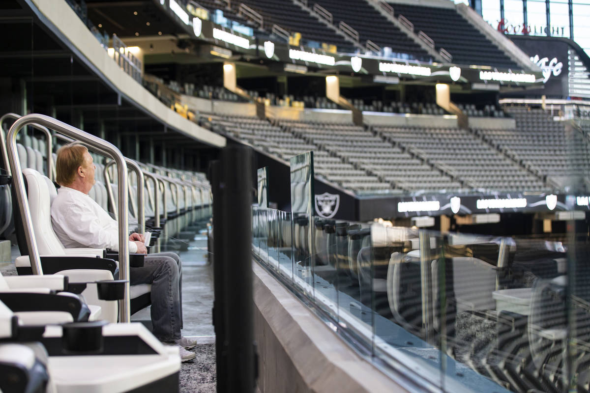 Mark Davis, owner of the Las Vegas Raiders, watches as members of Santa Fe & The Fat City H ...