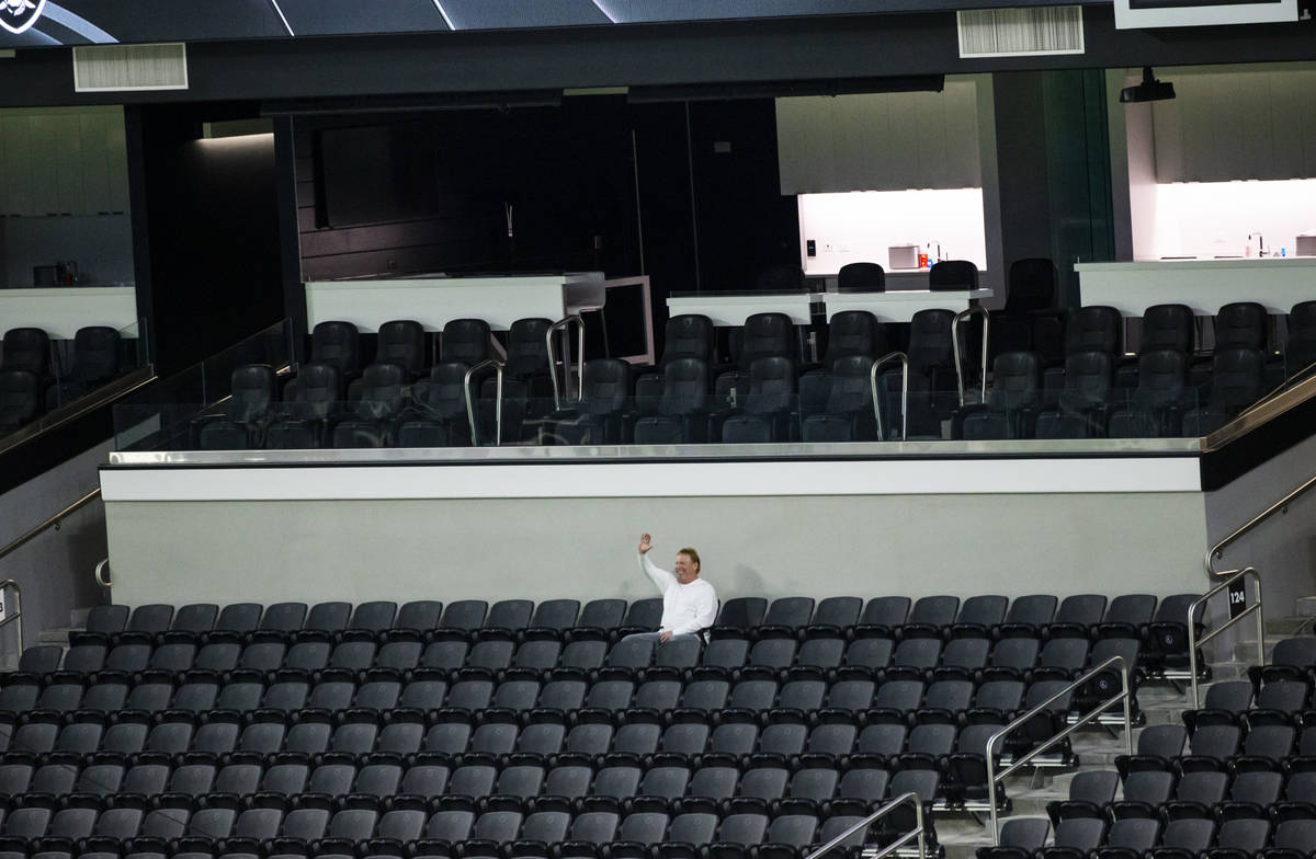 Mark Davis, owner of the Las Vegas Raiders, waves from his seat as members of Santa Fe & Th ...