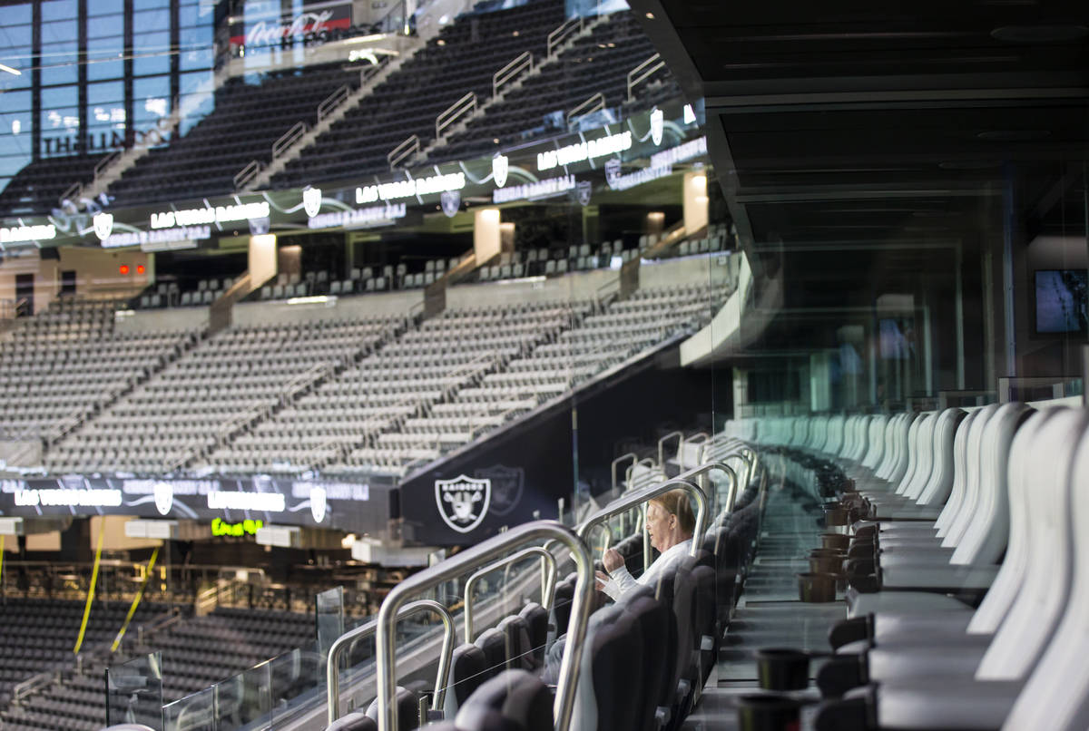 Mark Davis, owner of the Las Vegas Raiders, listens as members of Santa Fe & The Fat City H ...