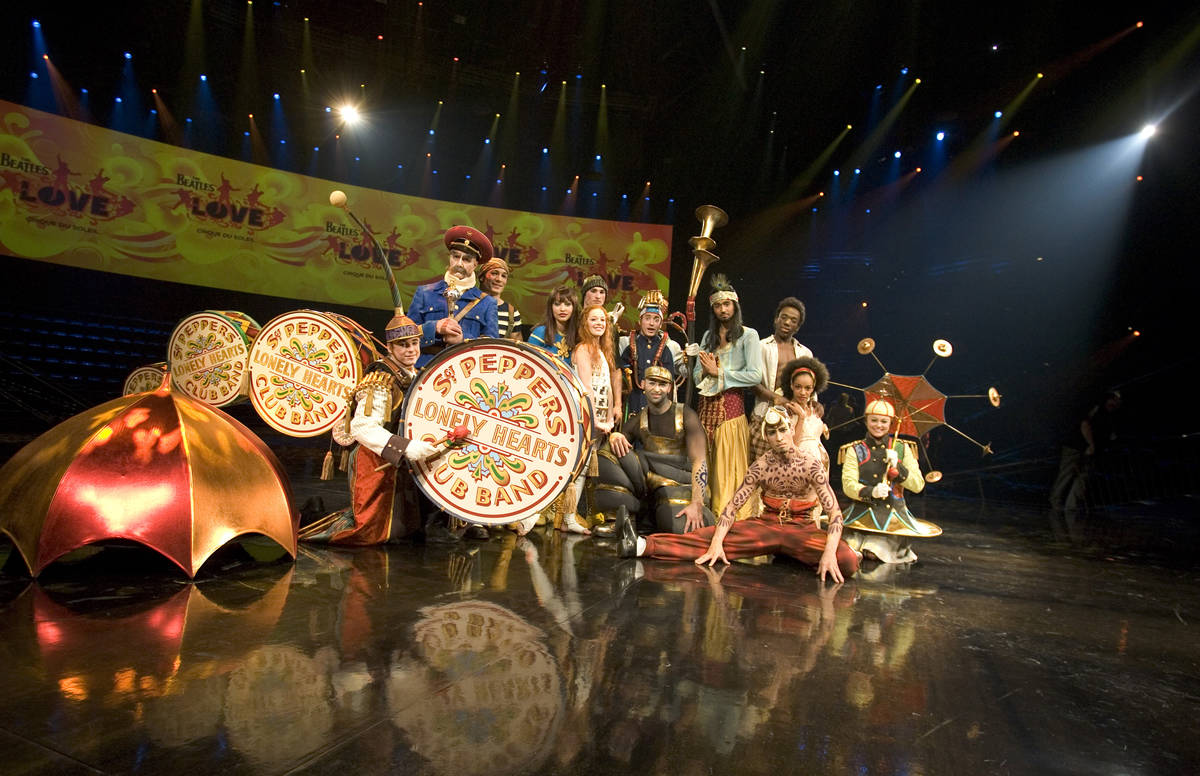 Cast members of Cirque du Soleil's LOVE poise for photographs during a media preview of the sho ...
