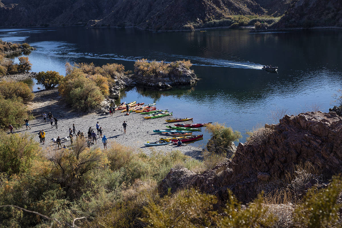 Kayakers rest on a beach along the Colorado River near Willow Beach in Ariz., Saturday, Dec. 5, ...