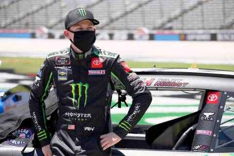 Riley Herbst stands next to his car prior to the NASCAR Xfinity auto race at Texas Motor Speedw ...