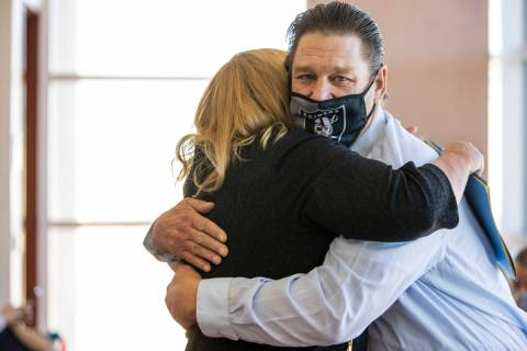 Fred Steese, right, hugs attorney Lisa Rasmussen following his settlement hearing at the Region ...