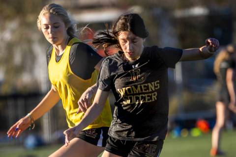 Player Camille Lomgabardi, front, drives the ball past a teammate during girlÕs soccer tea ...