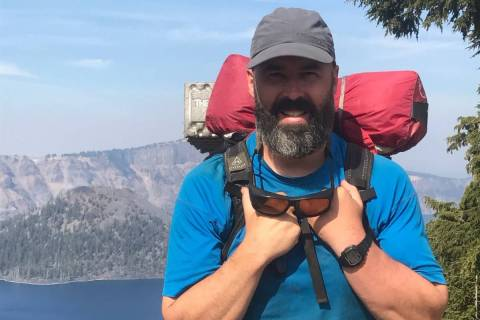 Thomas Driscoll, 57, poses while hiking in an undated picture. Driscoll, who grew up in Massach ...