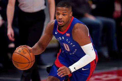 Detroit Pistons guard Dennis Smith Jr. brings the ball up court during the second half of an NB ...