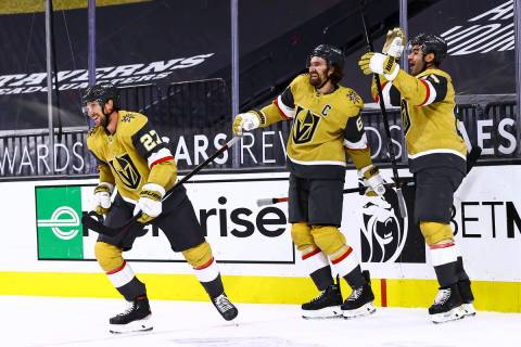 Golden Knights left wing Max Pacioretty, right, celebrates his overtime goal against the Anahei ...