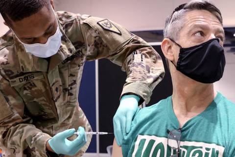 Pat McKeever, 53, who is a pilot with Southwest Airlines, receives the COVID-19 vaccine from Ne ...