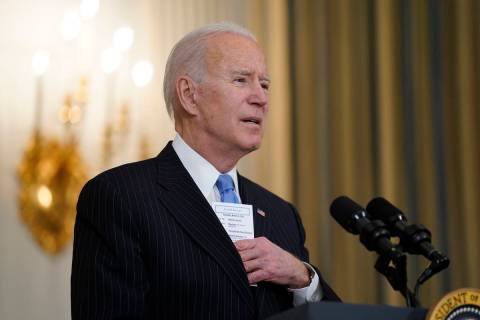 President Joe Biden speaks about efforts to combat COVID-19, in the State Dining Room of the Wh ...