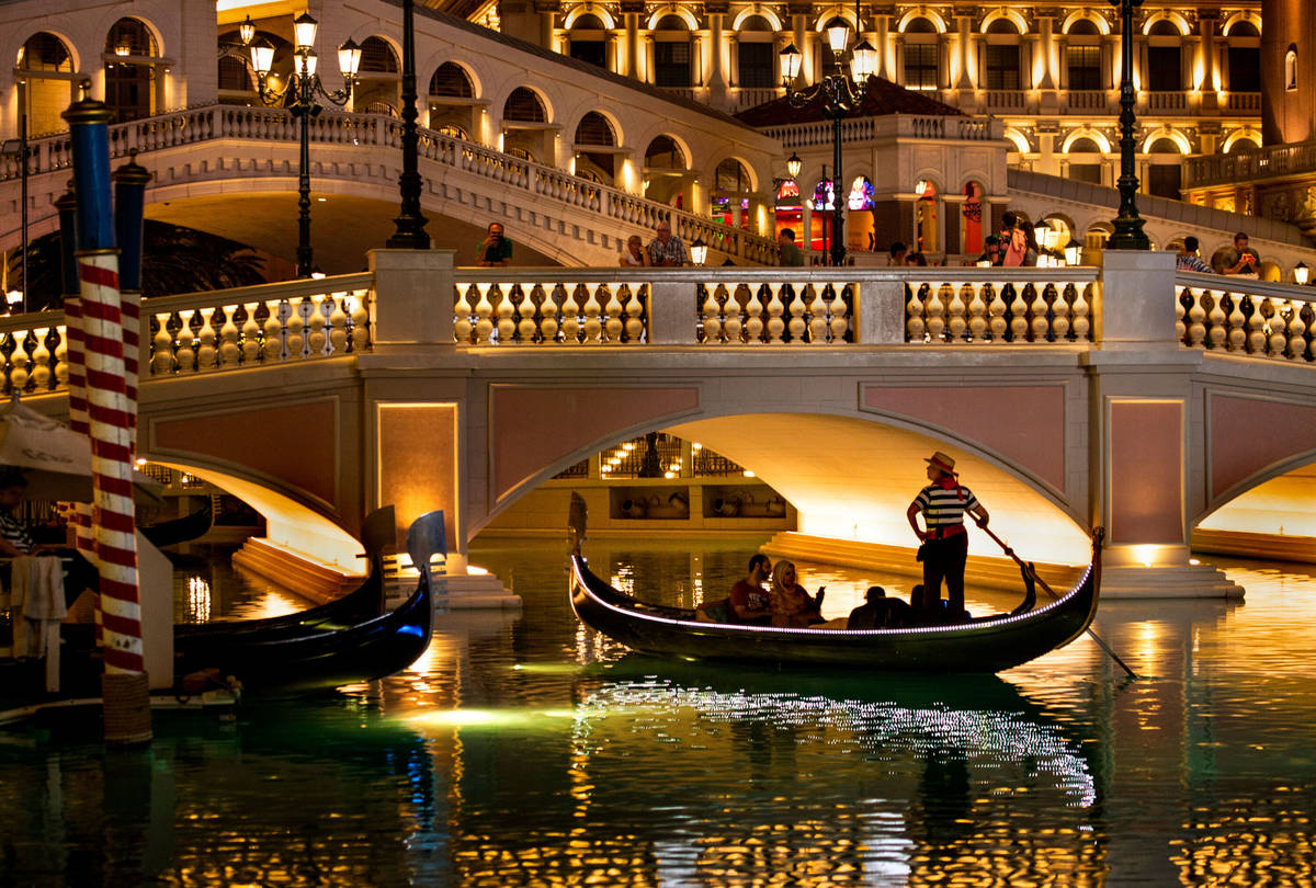 Tourists ride gondolas at The Venetian on Wednesday, April 24, 2019, in Las Vegas. (L.E. B ...