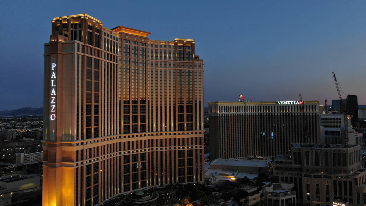 An aerial photo of the Palazzo and Venetian hotel casino properties at dusk, on Friday, April 3 ...