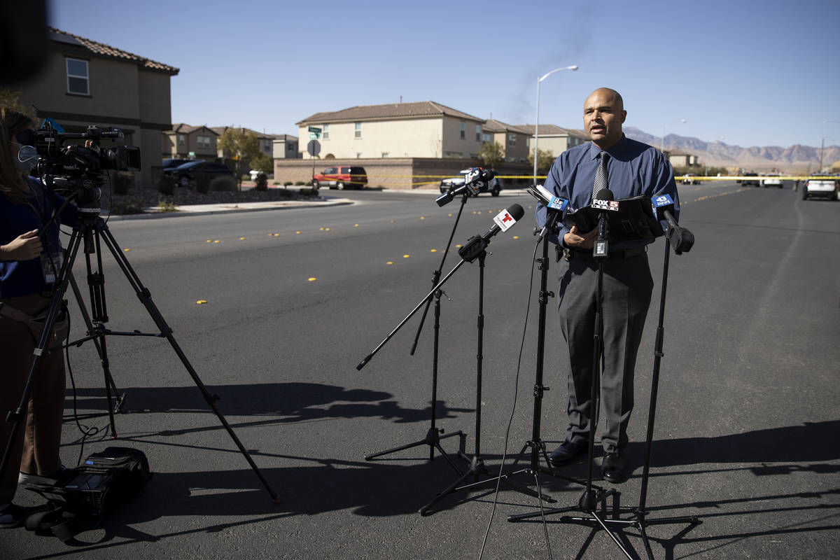 Metropolitan Police Department homicide Lt. Ray Spencer gives a press briefing on an apparent m ...