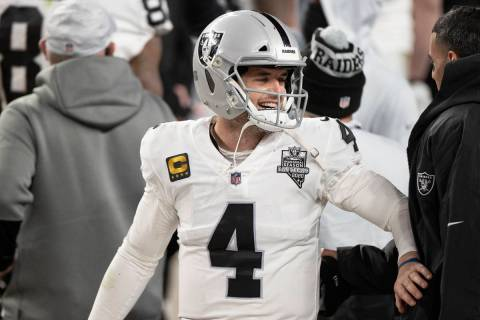 Raiders quarterback Derek Carr (4) celebrates after converting the winning two point conversion ...