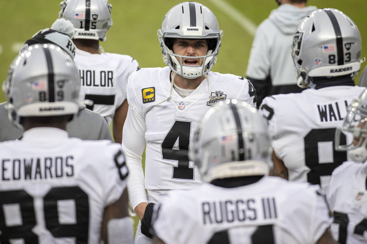 Raiders quarterback Derek Carr (4) fires up his team in the second quarter during an NFL footba ...