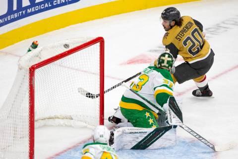 Golden Knights center Chandler Stephenson (20) scores a goal on Wild goaltender Cam Talbot (33) ...