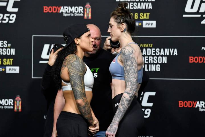 LAS VEGAS, NEVADA - MARCH 05: (L-R) Opponents Amanda Nunes of Brazil and Megan Anderson of Aust ...
