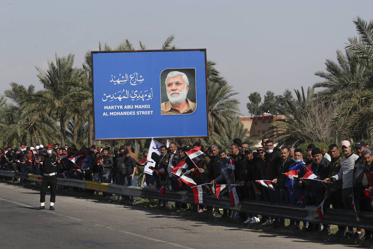 Peoplestand by the road as they wait for Pope Francis to pass by, in Baghdad Iraq, Friday, Marc ...