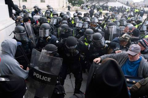 In a Jan. 6, 2021, file photo, U.S. Capitol Police push back rioters trying to enter the U.S. C ...