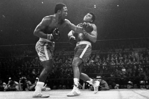 Joe Frazier hits Muhammad Ali with a left during the 15th round of their heavyweight title figh ...