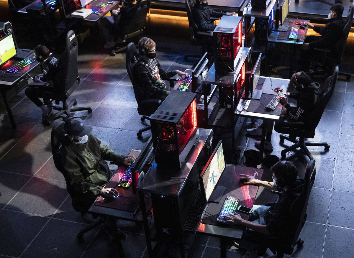 """Players compete during the Fortnite tournament """"Friday Night Frags""""at the HyperX Espo ..."""
