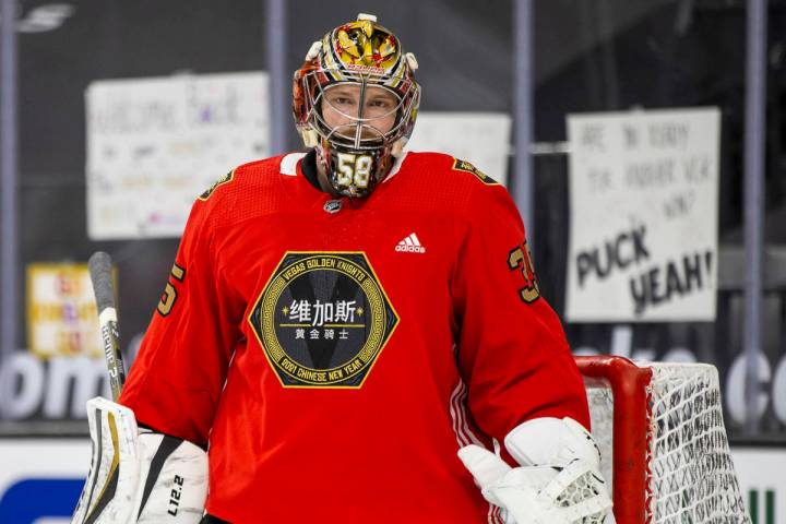 Golden Knights goaltender Oscar Dansk (35) looks on during warm ups before the first period of ...