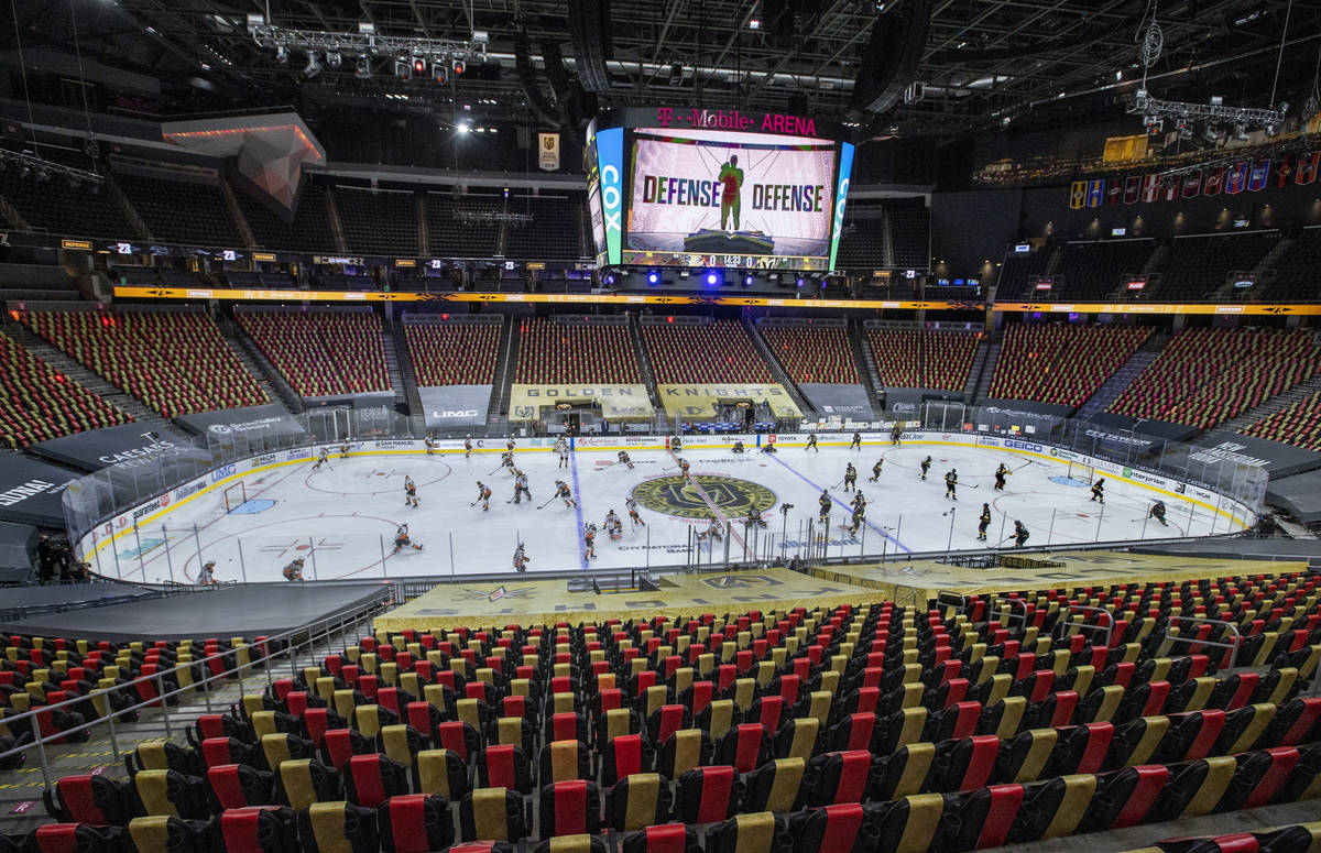 Golden Knights and Anaheim Ducks players take the ice during the warm ups of an NHL season-open ...