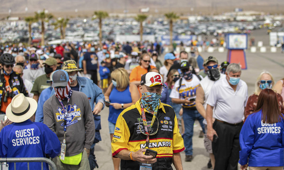 NASCAR fans get their tickets scanned before the start of the NASCAR Cup Series Pennzoil 400 a ...