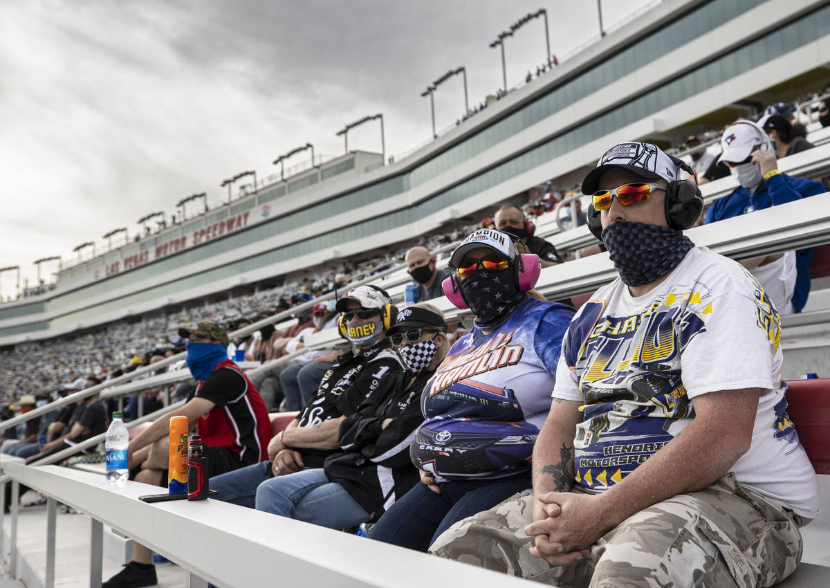 Fans enjoy the NASCAR Cup Series Pennzoil 400 auto race from the grandstands at Las Vegas Motor ...