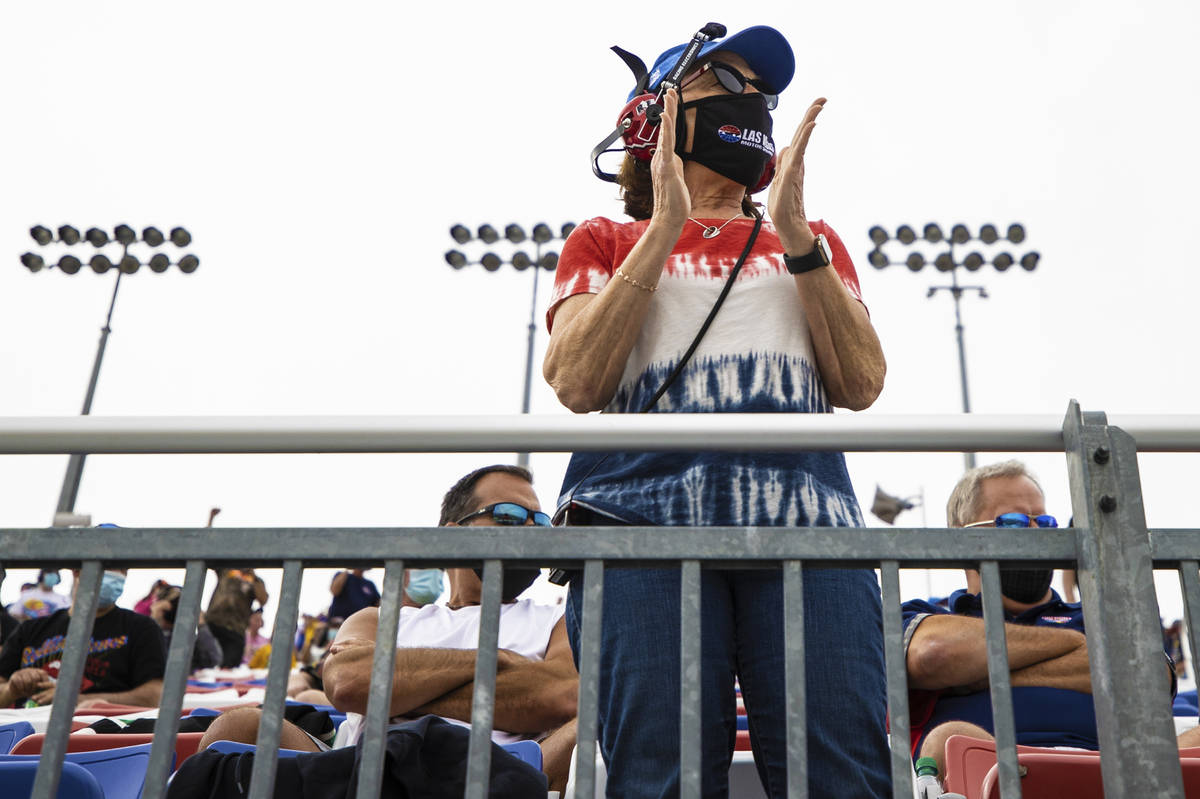 Fans cheer from the grandstands during the NASCAR Cup Series Pennzoil 400 auto race at Las Vega ...