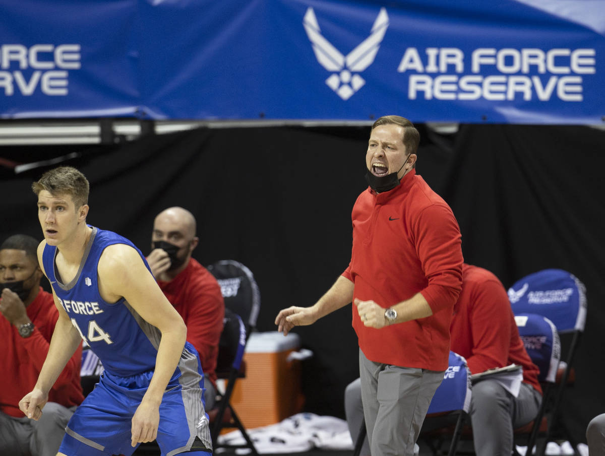 UNLV Rebels head coach T.J. Otzelberger, right, calls a defensive play in the first half during ...