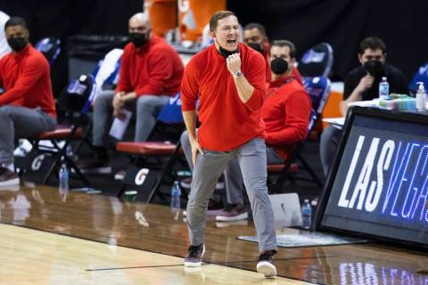 UNLV Rebels head coach T.J. Otzelberger directs his offense in the first half during the openin ...
