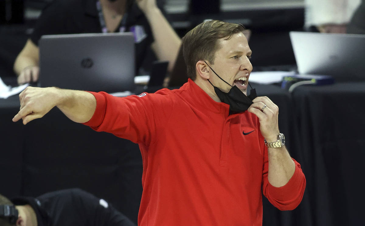 UNLV coach T.J. Otzelberger gestures during the second half of the team's NCAA college basketba ...