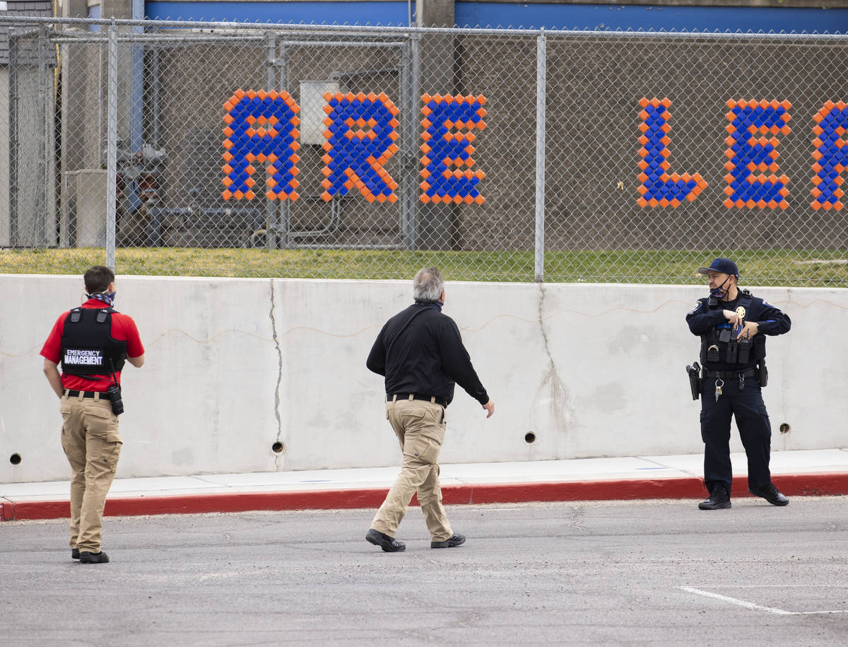Law enforcement officers investigate a shooting outside of George Harris Elementary School in L ...