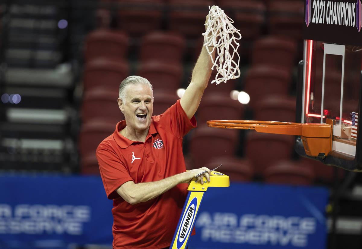 San Diego State Aztecs head coach Brian Dutcher celebrates after winning the Mountain West conf ...