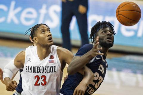 San Diego State Aztecs forward Joshua Tomaic (23) fights for a loose ball with Utah State Aggie ...