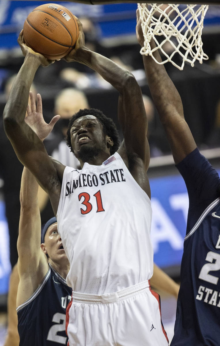 San Diego State Aztecs forward Nathan Mensah (31) drives to the rim past Utah State Aggies guar ...