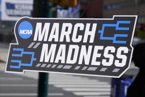 A March Madness sticker for the NCAA college basketball tournament is placed on a window in dow ...