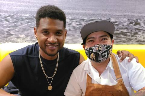 Usher is shown with Chef Pedro Vidal at Esther's Kitchen in the Arts District on Tuesday, March ...