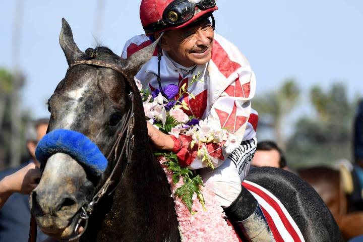 Jockey Mike Smith celebrates after riding Roadster to the win in the Santa Anita Derby horse ra ...