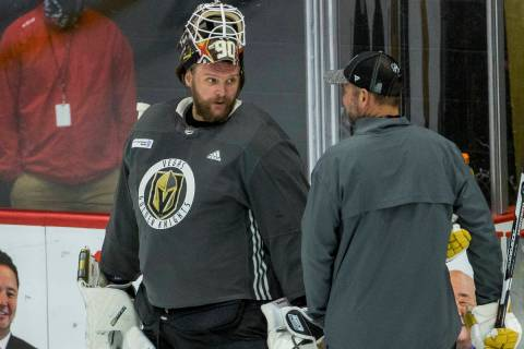 Vegas Golden Knights goaltender Robin Lehner (90, left) talks with head coach Peter DeBoer duri ...