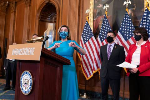 Speaker of the House Nancy Pelosi, D-Calif., joined at right by Rep. Raul Ruiz, D-Calif., chair ...