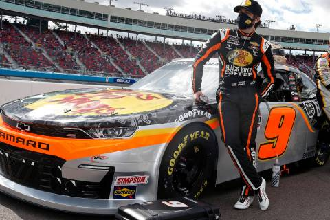 Noah Gragson, left, stands with his race car on pit road prior to a NASCAR Xfinity Series auto ...