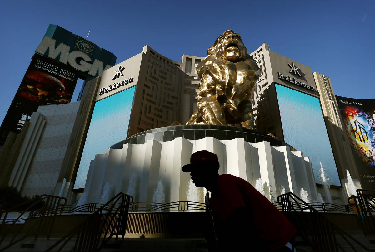 In this Aug. 3, 2015, file photo, a man rides his bike past the MGM Grand hotel and casino in L ...