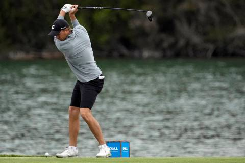 Jordan Spieth hits his tee shot on the 14th hole during a practice round for the Dell Technolog ...