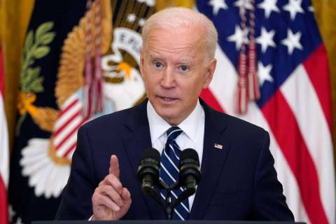 President Joe Biden speaks during a news conference in the East Room of the White House, Thursd ...