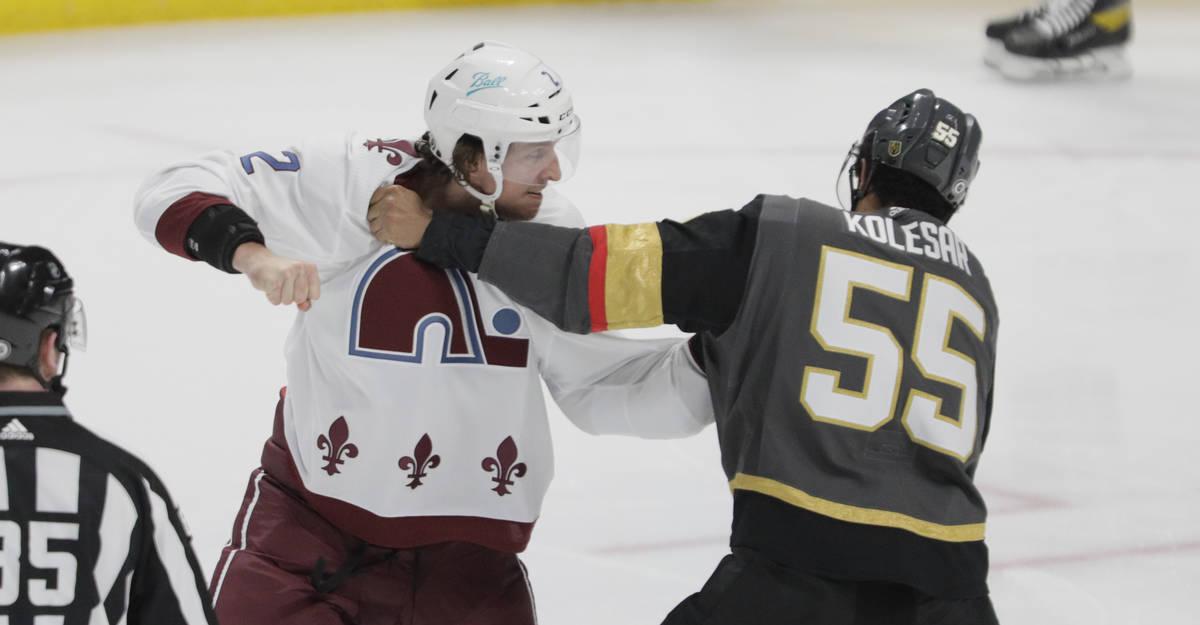 Colorado Avalanche defenseman Dan Renouf (2) fights Vegas Golden Knights right wing Keegan Kole ...