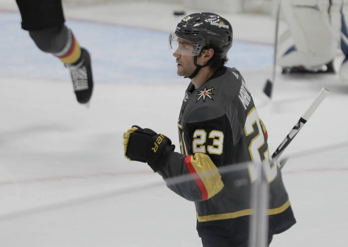 Vegas Golden Knights defenseman Alec Martinez (23) pumps his fist after a goal against the Colo ...